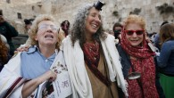 "Women of the ""Women of the Wall"" organization wear prayer shawls as they pray at the Western Wall, Judaism's holiest site, in Jerusalem on April 11, 2013.(photo credit: Miriam Alster/FLASH90)"