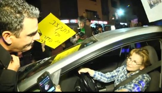Health Minister Yael German speaks to protesters upon leaving a Yesh Atid faction meeting April 13 (image capture/YouTube)
