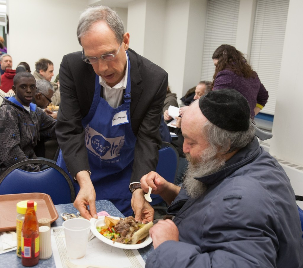 MK Nachman Shai (Labor) serves dinner to one of the guests at the JUF Uptown Cafe (photo credit: Steve Donisch)