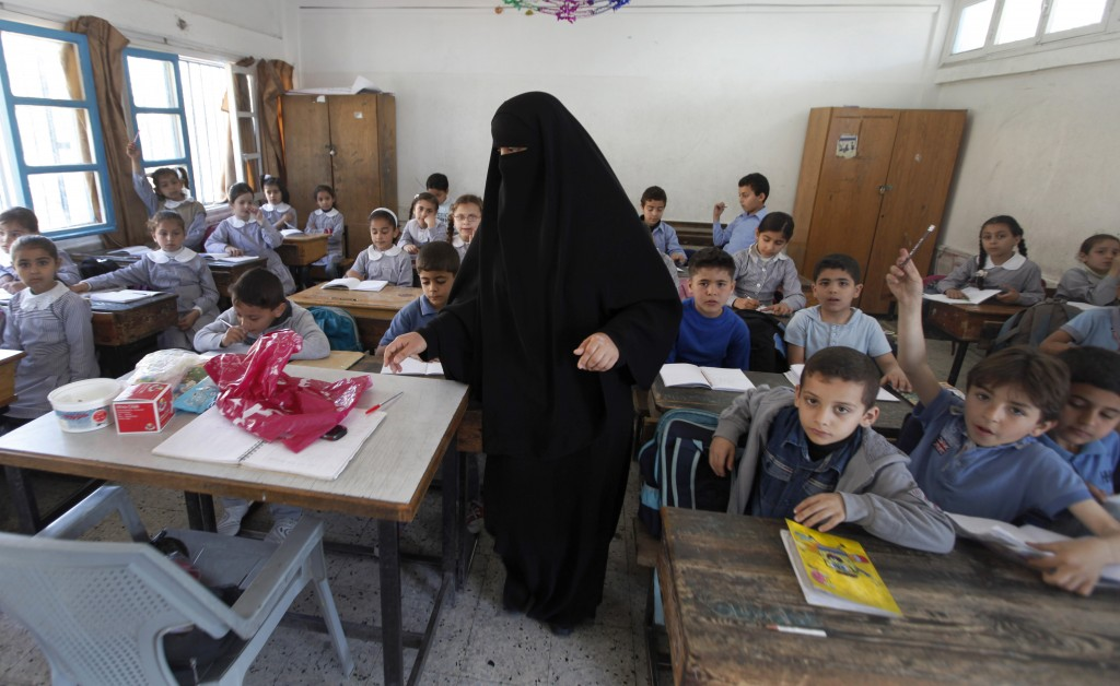 Palestinian children attend a class at the UNRWA elementary school in the Shati refugee camp in Gaza City, in April (Illustrative photo credit: AP/Hatem Moussa)