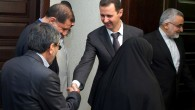Syrian President Bahsar Assad, center, shakes hands with a member of Iran's parliamentary committee on national interest and foreign policy, in Damascus, Syria, Monday, April 22, 2013 (photo credit: AP/SANA)