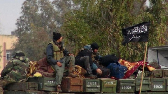 Rebels from the al-Qaeda affiliated Jabhat al-Nusra, as they sit on a truck full of ammunition in northern Syria, January 11, 2013. (photo credit: AP/Edlib News Network ENN)