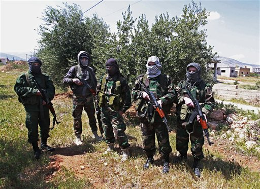 Lebanese pro-Syrian Popular Committees fighters near the northeastern Lebanese town of al-Qasr, Lebanon.(photo