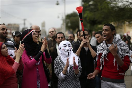 An illustrative photo of Egyptian protesters chanting anti Muslim Brotherhood slogans outside the presidential palace, in Cairo, Egypt, in December 2012. (photo credit: AP Photo/Hassan Ammar, File)