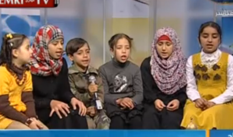 The grandchildren of late Hamas MP Umm Nidal sing the virtues of jihad and martyrdom on Hamas's al-Aqsa TV. (photo credit: image capture from MEMRI TV video)