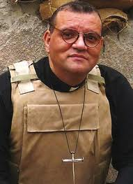 Andrew White in Baghdad, as seen on the cover of his 2009 book 'Faith under fire' (photo credit: Courtesy)