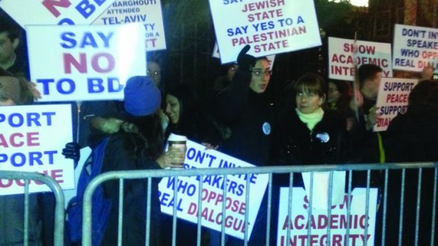 Brooklyn College students protest a BDS forum in February.