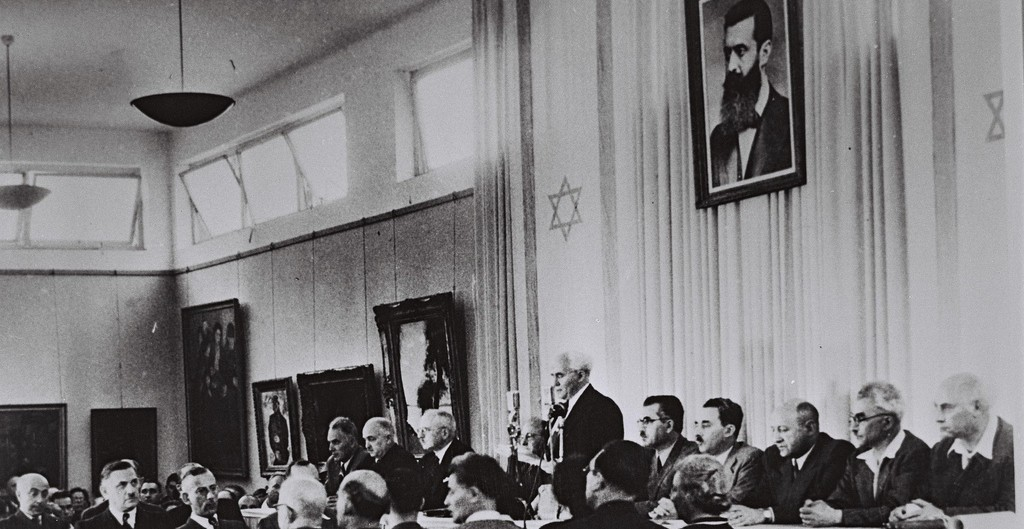 David Ben-Gurion, flanked by the members of his provisional government, reads the Declaration of Independence in the Tel Aviv Museum Hall on May 14, 1948 (photo credit: Israel Government Press Office)