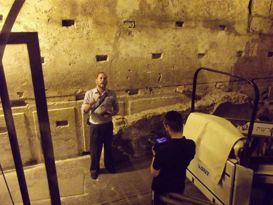 Harry Moskoff being interviewed inside the Western Wall Tunnels, the presumed location of the long-lost ark (Courtesy Harry Moskoff)