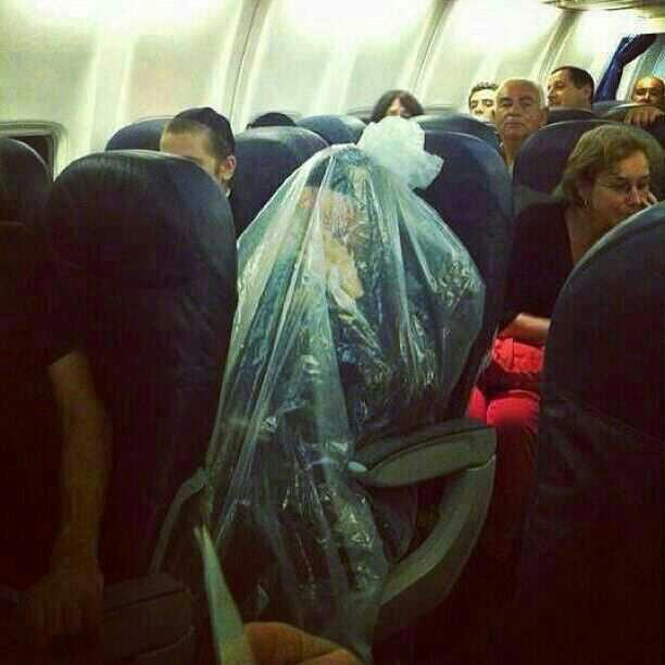 An ultra-Orthodox man is seen encased in plastic on a plane (photo credit: via Imgur)