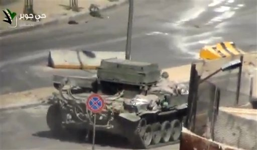 A Syrian Army tank in the streets of the Jobar district of Damascus, Syria, Friday, April 26, 2013 (photo credit: AP Photo/Ugarit via AP video)