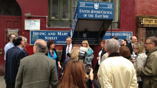 Diplomats visit the Lower East Side, including a stop at the Bialystoker Shul, right, as part of AJC program.