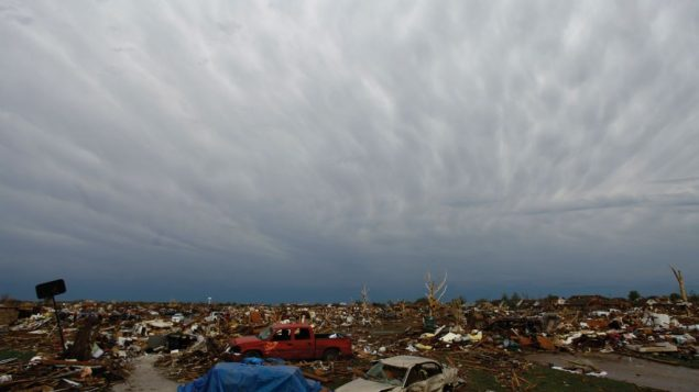 The huge tornado that ripped through Moore, Okla., left destroyed homes and cars in its wake. Photos by Getty Images