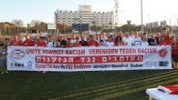 """Israeli and Dutch Soccer fans carrying a sign reading """"fans against racism"""" at an event in Tel Aviv, 2011. JTA"""