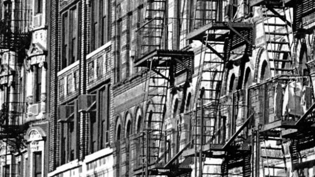 Sid Kaplan's photo of Lower East Side tenement buildings amid a pattern of fire escapes.