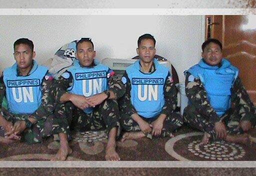 A photo of  Filipino UN peacekeepers kidnapped from their Golan outpost by the Yarmouk Martyrs Brigade in Ma