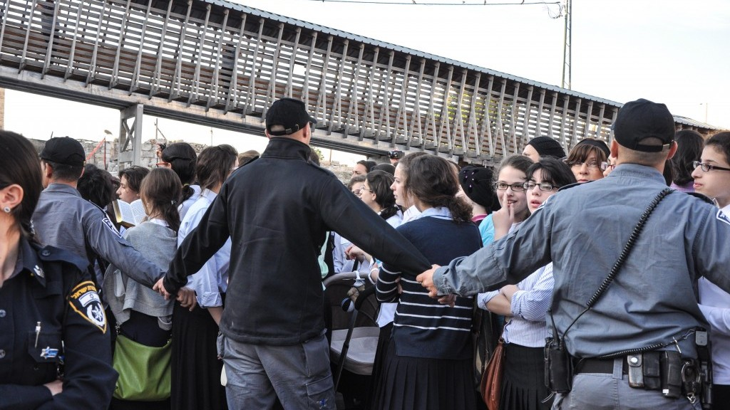Though less violent than their male counterparts, ultra-Orthodox teen girls jeered and cursed at the members of the Women of the Wall prayer service Friday (photo credit: Michal Shmulovich/Times of Israel)