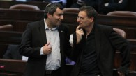 Zeev Elkin speaking with left-wing politician Dov Khenin in the Knesset in February. (photo credit: Miriam Alster/Flash90)
