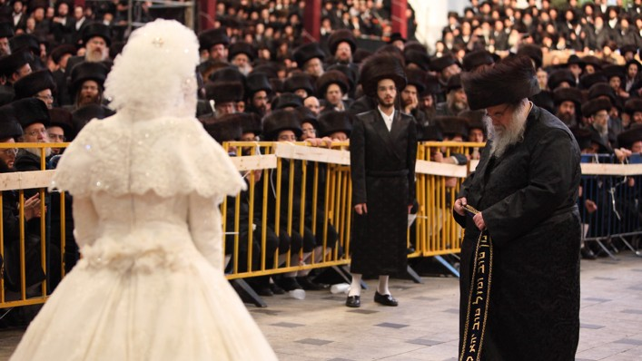 Tens of thousands of Ultra-Orthodox Jews from the Belz Hassidic dynasty attend the wedding ceremony of Rabbi Shalom Rokach, the grandson of the Belz Rabbi, to Hana Batya Pener on May 22, 2013. (Photo credit: Yaakov Naumi/Flash90)