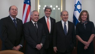 US State of Secretary John Kerry (center) poses for a group picture with, from left to right, Defense Minister Boogie Yaalon, Minister of International Relations Yuval Steinitz, Prime Minister Benjamin Netanyahu and Minister of Justice Tzipi Livni, at Netanyahu's office in Jerusalem on May 23, 2013. (photo credit: Marc Israel Sellem/Pool/Flash90)