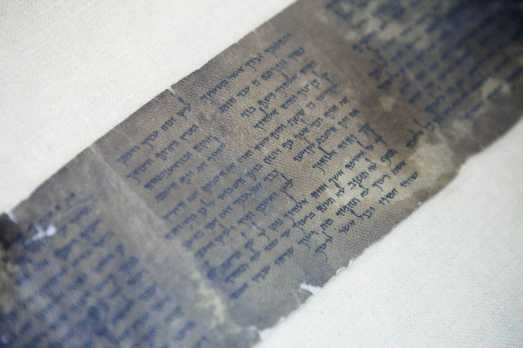 This photo shows the Ten Commandments written on one of the Dead Sea Scrolls in Jerusalem. (photo credit: AP/Dan Balilty)