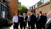Syrian President Bashar Assad, center, visits the Umayyad Electrical Station on May Day, May 1, 2013, a day after a powerful bomb hit the capital (photo credit: AP/SANA)