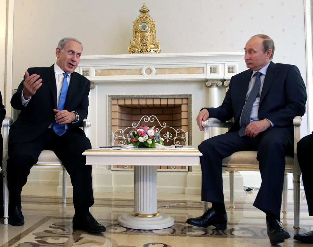 Russian President Vladimir Putin Right Listens To Israeli Prime Minister Benjamin Netanyahu During Their