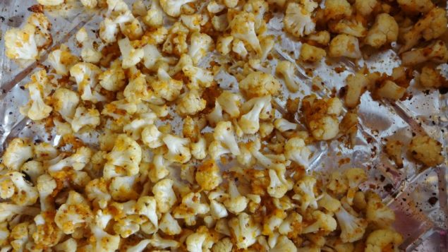 Toss cauliflower with honey and mustard before baking for a sweet treat. Amy Spiro