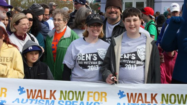 Mom and Ben at the Walk for Autism. Ben cut the ribbon to start everybody off. Photo courtesy Rabbi Rebecca Schorr