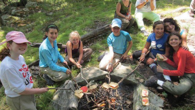 Campers at Eden Village Camp cook over an open fire. Photo courtesy Eden Village Camp