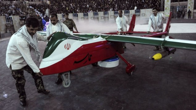 In this picture released by the Iranian Students News Agency, men move the Epic drone, painted with the Iranian flag colors, during a ceremony in Tehran, Iran, Thursday, May 9, 2013. Iran's defense minister says Iran has built a new, radar-evading drone that can do surveillance and fire on enemy targets. (photo credit: AP/ISNA, Hemmat Khahi)