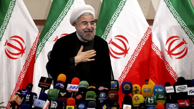 Iran's newly elected president Hasan Rouhani places his hand on his heart, as a sign of respect, after speaking at a press conference, in Tehran, Monday, June 17, 2013. (photo credit: AP/Ebrahim Noroozi)