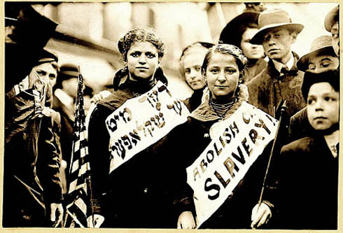 """ABOLISH CHILD SLAVERY!!"" in English and Yiddish, probably taken during May 1, 1909 labor parade in New York City. Jewish American women have often been at the forefront of social change. (Photo credit: George Grantham Bain Collection, Library of Congress)."