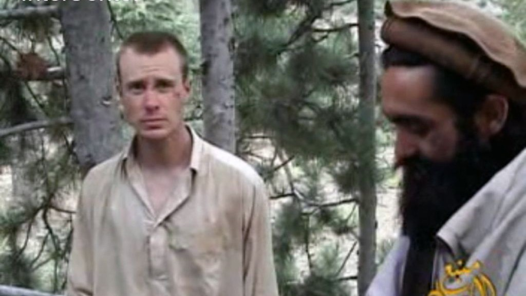 Frame grab from a video released by the Taliban containing footage of a man believed to be Bowe Bergdahl, left. (photo credit: AP/IntelCenter/File)