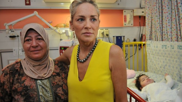 Sharon Stone meets with the parent of a hospitalized child at Hadassah's pediatric AIDS unit in Jerusalem on Tuesday June 18, 2013. (Photo credit: Courtesy)