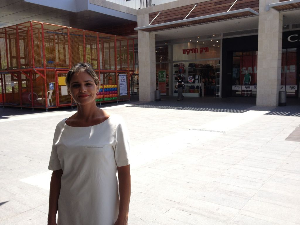Avital Binyamin outside her Ramot Mall store, which has been experiencing a severe downturn in sales (photo credit: Jessica Steinberg/Times of Israel)