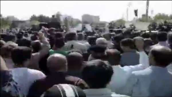 Iranians attending a funeral for a religious leader protest against the country's supreme leader Ayatollah Ali Khamenei, June 4, 2013. (screen capture: BBC News)