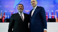 Turkey's Prime Minister Recep Tayyip Erdogan, right, and Egyptian President Mohammed Morsi salute the members of Turkey's ruling Justice and Development Party in Ankara, Turkey in Sept. 2012 (photo credit: AP/Kayhan Ozer)