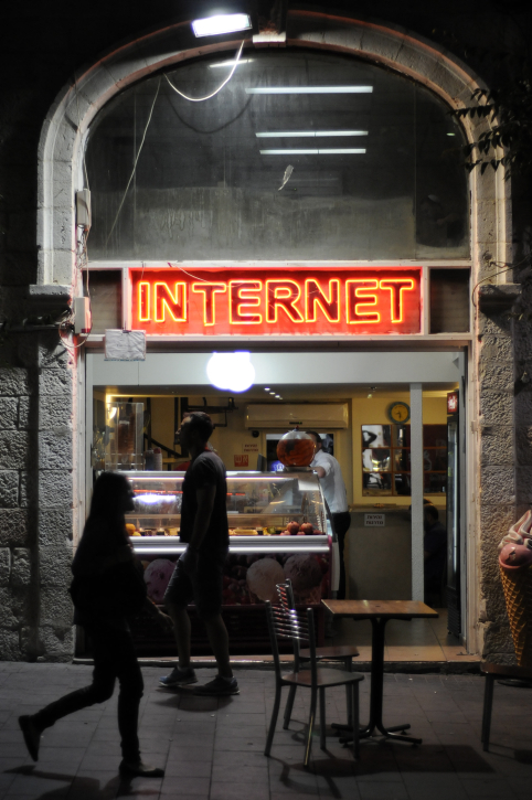 .Pedestrians pass a cafe with internet on Jaffa St, Jerusalem on October 21, 2012. (photo credit: Louis Fisher/Flash90)