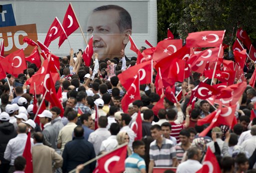 Supporters of Turkish Prime Minister Recep Tayyip Erdogan wait for his arrival in Ankara, Turkey, on Sunday, June 9, 2013. (photo credit: AP/Vadim Ghirda)