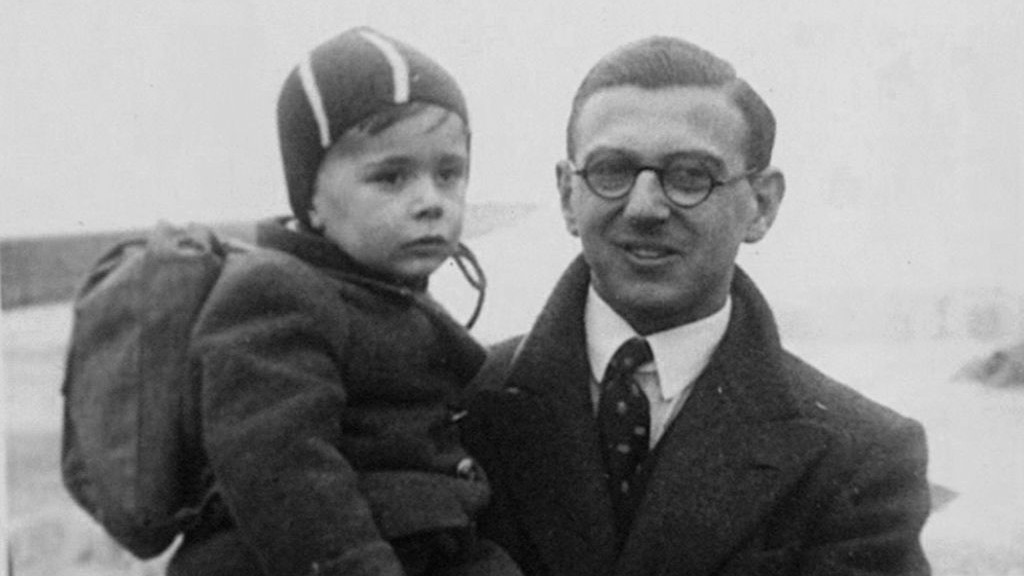 A young Nicholas Winton with a rescued child. (photo credit: Courtesy of Menemsha Films)