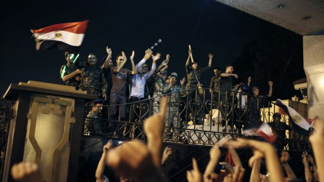 Egyptian protesters and members of the Republican Guard celebrated Mohamed Morsi's removal from power. Getty Images