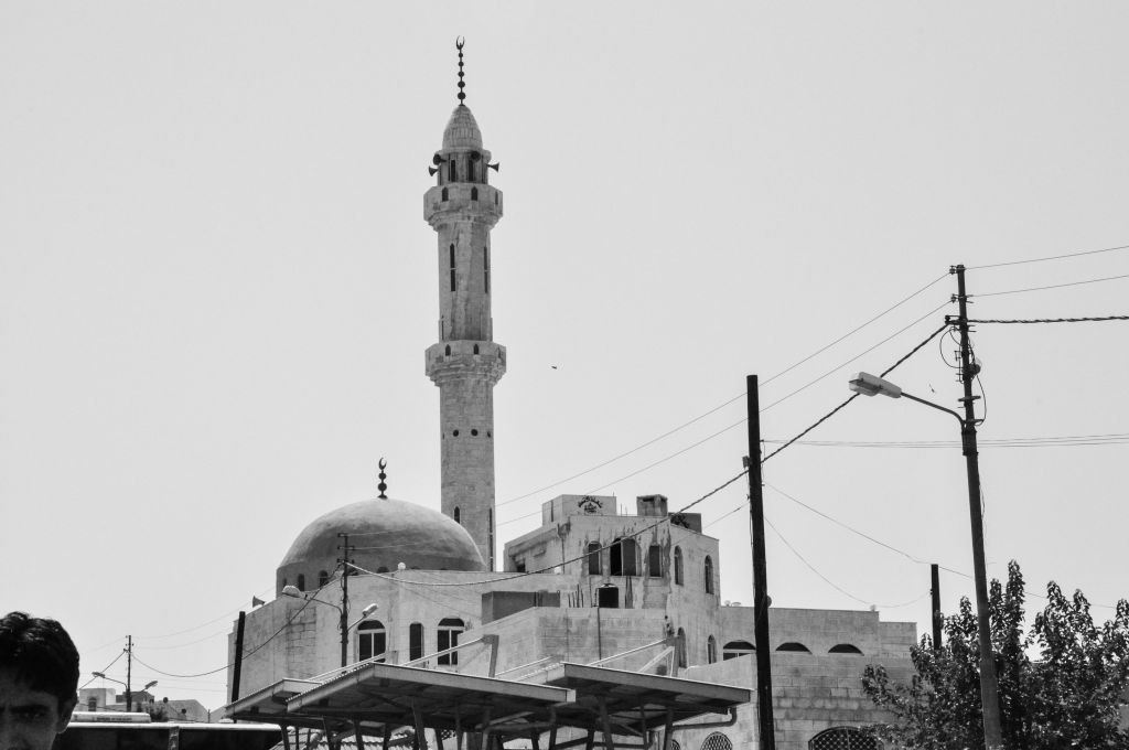 A mosque outside one of the main bus stations on the outskirts of Amman (photo credit: Michal Shmulovich/Times of Israel)