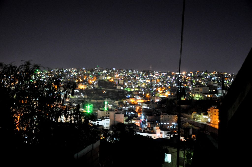 A view of the Amman skyline, dotted by the lights of minarets, at night (photo credit: Michal Shmulovich/Times of Israel)