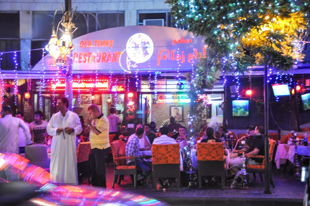 Cafes cater to people who want to smoke shisha, or water pipes, and indulge in treats late into the night (photo credit: Michal Shmulovich/Times of Israel)
