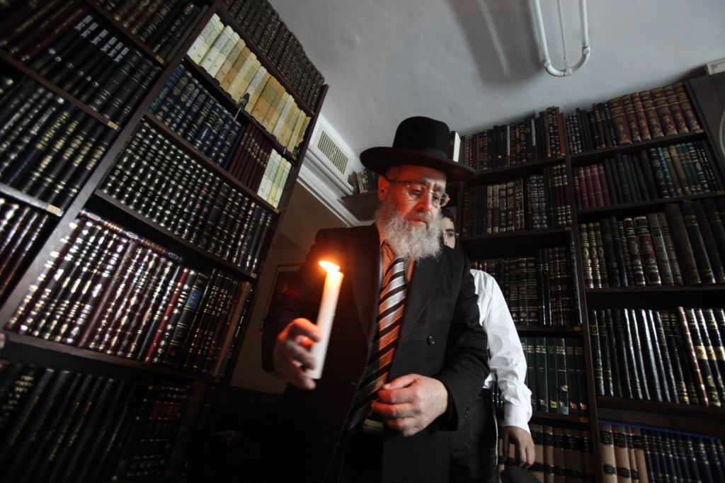 Rabbi Yitzhak Yosef, performing the ritual 'search for leavened bread' before the Passover holiday in 2009. (photo credit: Yossi Zamir/Flash 90).