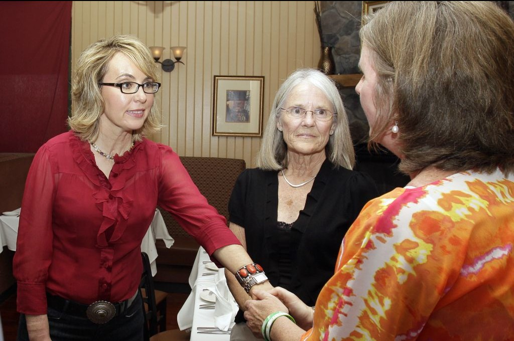 Former Arizona Rep. Gabrielle Giffords greets Jackie Barden, right, mother of a Sandy Hook Elementary School shooting victim Daniel Barden, as local supporter Mary Ann Sosnoff, center, looks on at the Orchard Street Chop Shop in Dover, NH. (photo credit: AP Photo/Mary Schwalm)