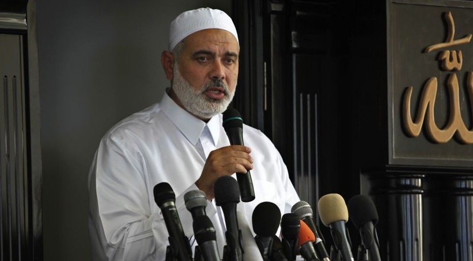 Gaza's Hamas Prime Minister Ismail Haniyeh gives a speech during Friday prayers in the Bureij refugee camp, central Gaza Strip, on July 5, 2013. (photo credit: AP/Adel Hana)