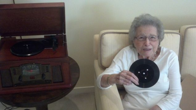 The author's grandmother with the record containing birthday greetings from her deceased family. Rabbi Jason Miller