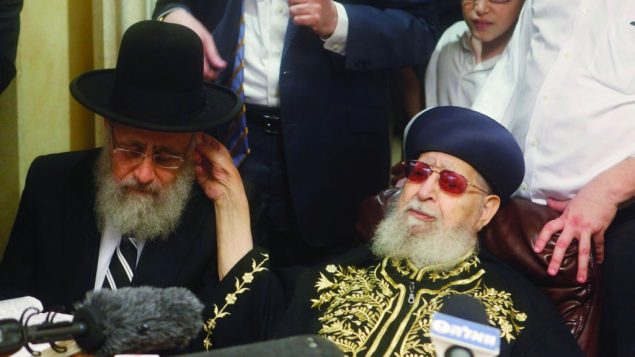 Former Sephardic Chief Rabbi Ovadia Yosef, right, congratulating his son, Rabbi Yitzhak Yosef Lau.